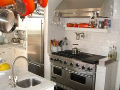 Mmmmm... Viking stove and great open shelves and racks.