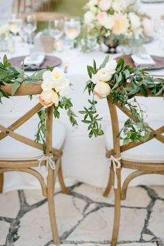 Very romanic — garland that adorns the backs of the bride and groom's chairs.