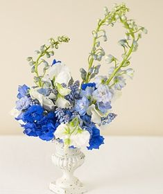 Blue Delphinium -height of delphinium, sweet pea, and muscari will fill a space without preventing cross-table conversation