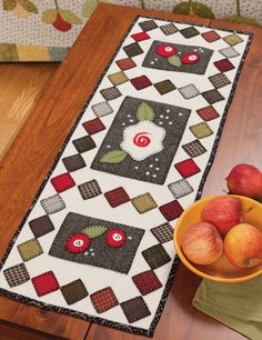 Very charming wool applique quilted table runner, from Home Sweet Quilt.
