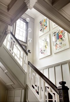 #Craftsman style wooden #staircase with #traditional details and #contemporary art