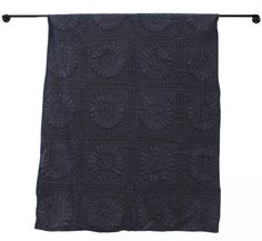 An over-dyed floral quilt has a new dignity in a strong solid shade of indigo; $300 at Shark Tooth.
