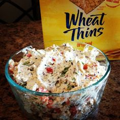 Party dip (they suggest to double the recipe for parties since it goes so fast). 16oz cream cheese, softened 1 pkg dry ranch dressing mix   2oz chopped black olives 2 jalepeno peppers, unseeded and chopped 1 red pepper, chopped 2/3 C. cheddar cheese