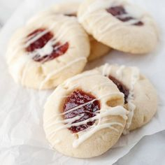 Raspberry Almond Thumbprints -   3 doz.  Ingredients:   For the cookie:  1 cup butter, room temperature  2/3 cup sugar  1/2 teaspoon almond extract  2 cups flour  1/4 cup raspberry jam  For the glaze:  1/2 cup confectioners' sugar  1 teaspoon almond extract  1 tablespoon milk  350°F fot 10-15 min.