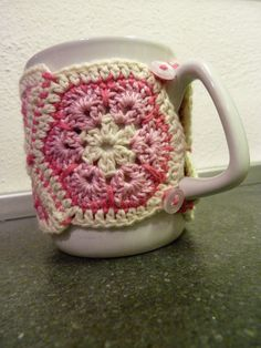 Crochet mug cosy made from african flower hexagon