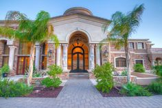 Mediterranean entry with iron and glass door / transom unit - Phoenix, Arizona
