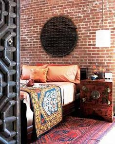 Love the brick wall and the warm colors