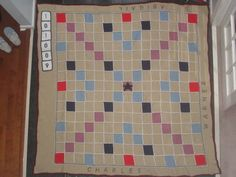 A Scrabble afghan by azabuey, made for a wedding gift, with the couple's names and wedding date included.  Wow.