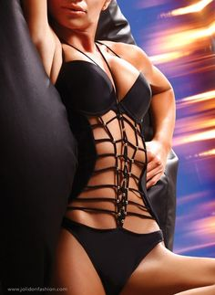 Hypnotizing Black One Piece Bathing Suit. Stand out from the crowd with this Hypnotizing Black One Piece Swimsuit by Jolidon. The Push Up padded cups give amazing lift and support, while the bold strappy design will elongate and enhance your beautiful curves.  Preformed Push Up Cups with underwires and extra padding - offers maximum bust enhancement and support. Ties around the neck with double strings and closes with metal clasp in the back. | http://caribbeanbeachwear.tumblr.com