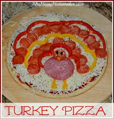Turkey Pizza - as in it LOOKS like a turkey! How CUTE is this? Kids & adults alike will love putting this together, and it's super easy! Perfect for a pre-Thanksgiving dinner.