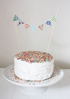 maybe something like this for the smash cake?  but with aqua and red flags?