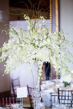 Tall Centerpieces   See the wedding on SMP: http://www.StyleMePretty.com/2014/03/13/new-york-athletic-club-wedding/ Photography: Kelsey Combe
