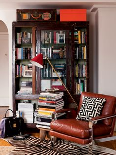 cognac leather & chrome chair + bookcase (nate berkus)