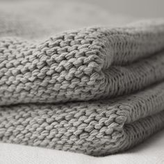 . Put this knit blanket over sheets then duvet cover over knit blanket. Beautiful layering ! Around $130 for a king size.