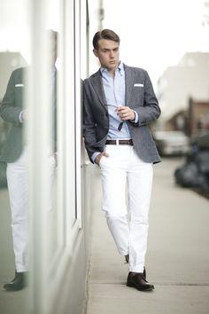 Light grey tweed jacket, light blue shirt, white pants