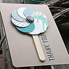 Swish circles together to create this fun handmade thank you card.  Use a real wooden stick as the handle on this popsicle stick.  Use a button, rhinestone, paint puddle or anything of your choice for the center.  The colors can complement each other, like the teal colors do here, or your circles can be all one color.