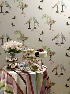 Nina Campbell's PERROQUET wallpaper is more femme than my taste usually runs, but I like it in black. #wallpaper #parrots