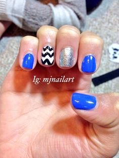 Neon blue nails with a chevron accent nail