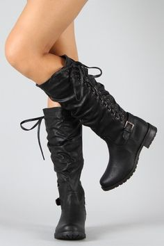 I don't know why the model looks like she has to pee, but cute boots.