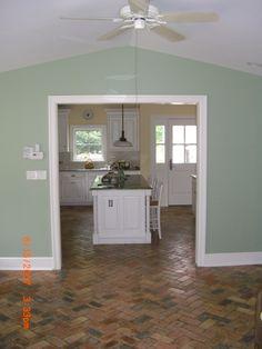 Love this kitchen brick flooring