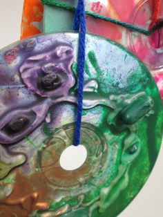 Close up of Melted Crayon CD Art displayed at AMPL's Spring 2013 Teen Art Exhibit Opening.