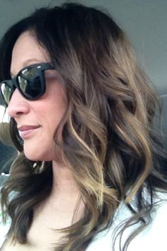 hair color. dark brown base with peek-a-boo highlights.