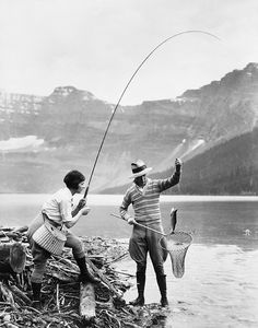 Marjorie Oliver and Vic Valentine catching a fish, Waterton Lakes National Park, Alberta, c. 1920s. #vintage #Canada #camping #fishing
