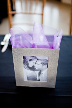 Favor bags with engagement pics on them. Photography by ivy-weddings.com