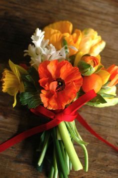 Orange, yellow, red, white and green flowers.