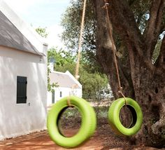 A simple tire swing painted green adds a citrusy dash of color to the garden.