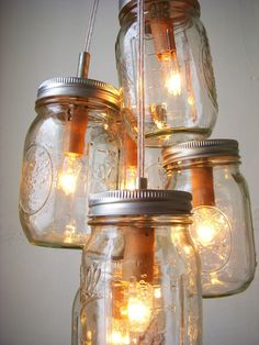 Love this idea for outside lighting on a porch.     The Yellow Cape Cod: apothecary jars