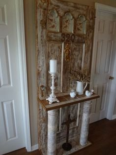 Vintage door turned into hall tree for the entrance.
