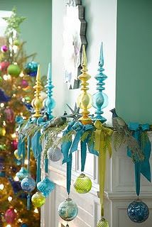 Ornaments suspended by ribbons on mantel