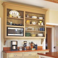 This built in, yet looks freestanding due to different paint kitchen cupboard~coffee station, display shelving, works perfectly in the space
