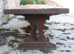 Replica medieval trestle table end view showing typical gothic style shape to trestle supports. Note the glorious twist in the top.