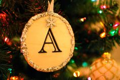 This Glitter Monogram Ornament will help you make your mark on the Christmas tree this year.