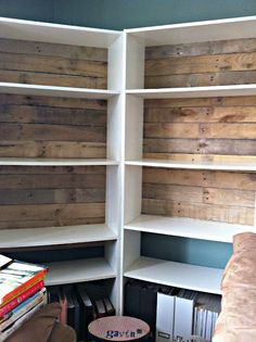 Back an ordinary book shelf with pallet boards....from dull to interesting!