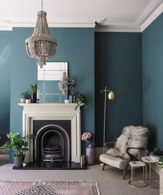 Living room painted in Inchyra Blue, ceiling in Shaded White and the fire surround in Drop Cloth.  All by Farrow & Ball