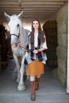 Mustard yellow pleated skirt paired with leather riding boots. #equestrian #shopruche #ruche