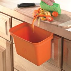 Hang this silicone bin on the edge of a drawer so it's easy to sweep in fat trimmings from meat, or fruit and veggie scraps