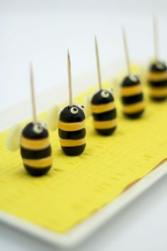 Project Denneler: Adorably Easy and Cheesy Bumblebee Appetizers made from cheese and olives.