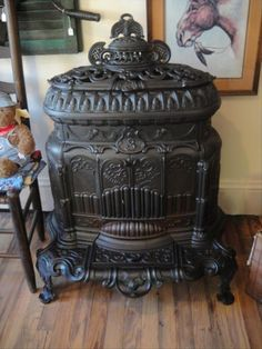 Would love a room with an old victorian wood burning stove! Rare Victorian Parlor Stove Wheeling WV 1864