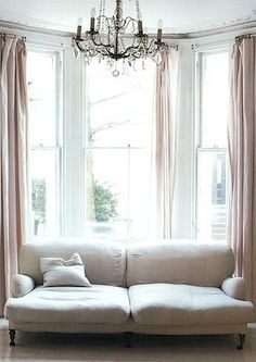 Sofa in front of window with simple panels Simple Style by Julia Bird via dwellingsanddecor.tumblr.com