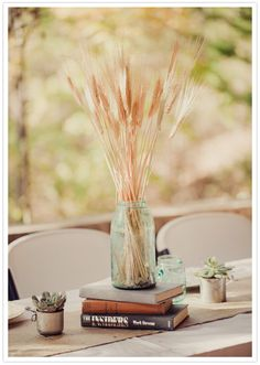 wheat stalk and mason jar centerpieces.