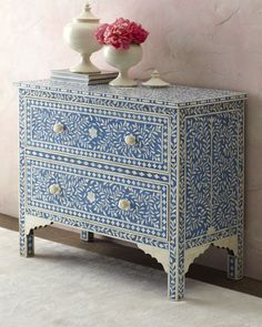 Bone inlay and handpainted blue and white chest of drawers - pretty in the living room or in a small foyer.  Neiman Marcus.