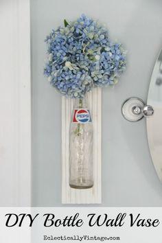 Bottle Crafts - DIY Bottle Wall Vase Tutorial eclecticallyvintage.com
