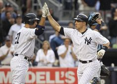 GAME 55: Wednesday, June 6, 2012 - New York Yankees' Mark Teixeira, right, is greeted by Raul Ibanez after hitting a solo home run during the second inning of a baseball game against the Tampa Bay Rays at Yankee Stadium in New York. (AP Photo/Seth Wenig)