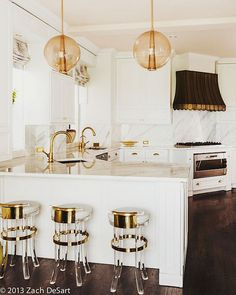 Black and White Kitchens | Lucite + Brass bar stools | Kemble interiors