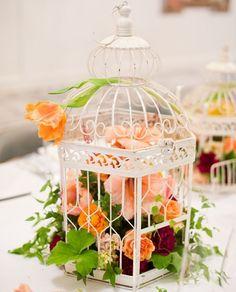 birdcage centerpiece with florals #diy | 20 DIY Wedding Centerpieces via Brit + Co.