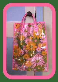 Plastic floral tote loaded with suntan lotion and bathing caps on every trip to the pool club.